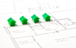 tiny house models on top of construction blueprint plan