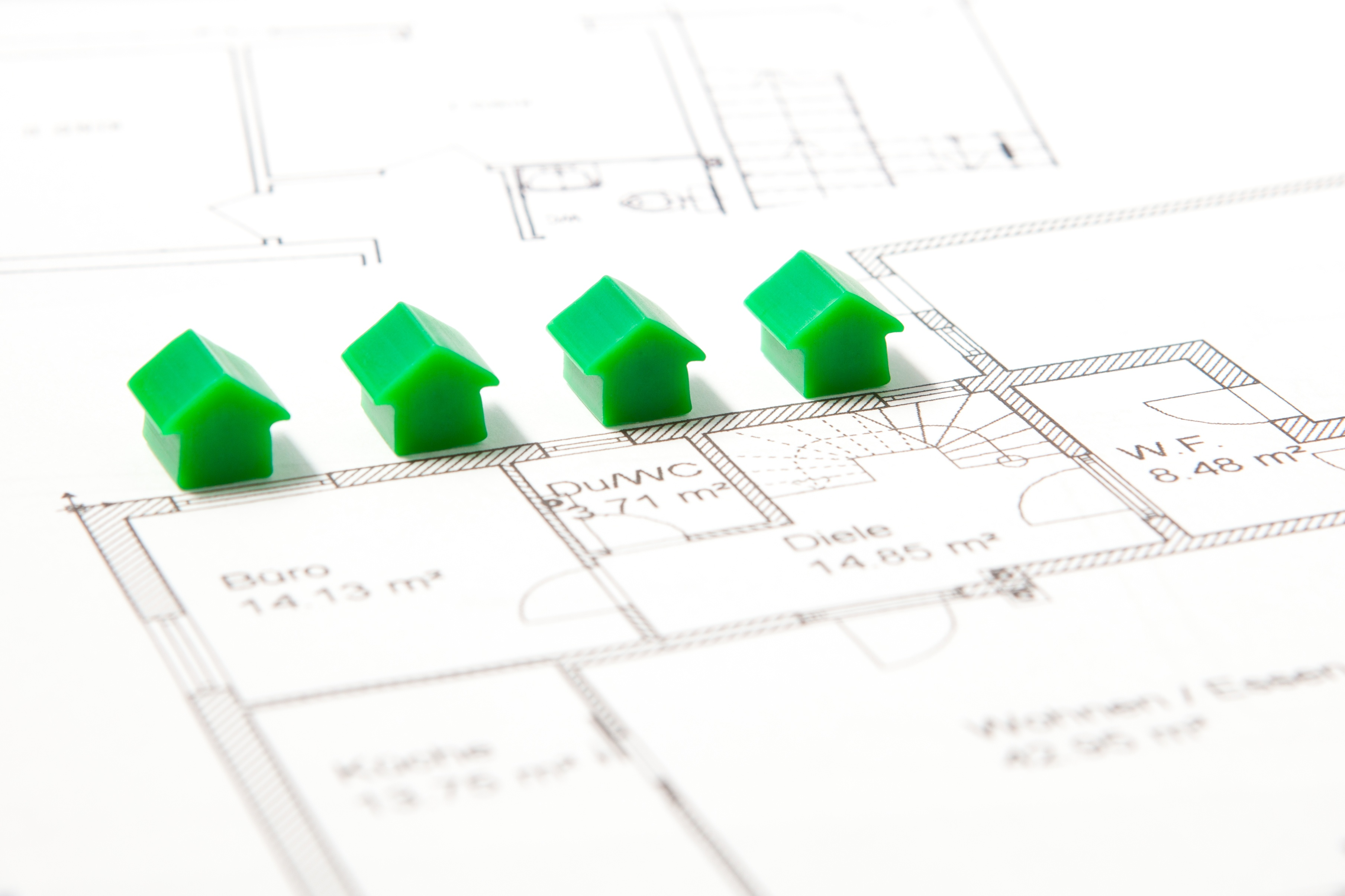 tiny houses on top of construction blueprint plan