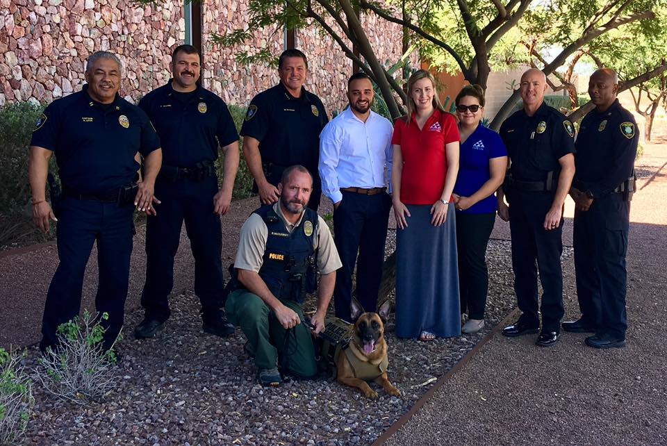 Police officer and citizens pose for picture with K9