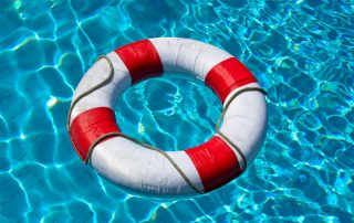 life buoy in blue swimming pool