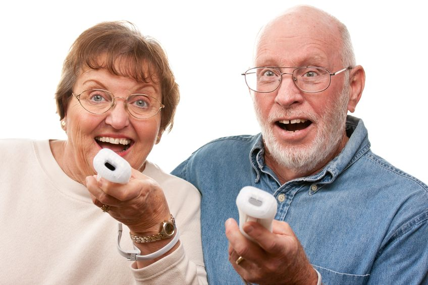 Senior citizens playing wii videogame