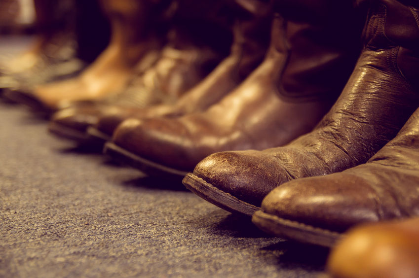 Row of brown cowboy boots