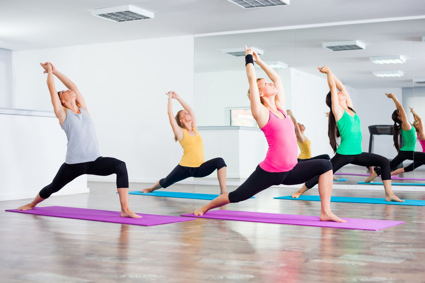 Four women practicing yoga infoors