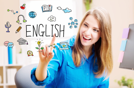 english concept with young woman clicking letters in the air