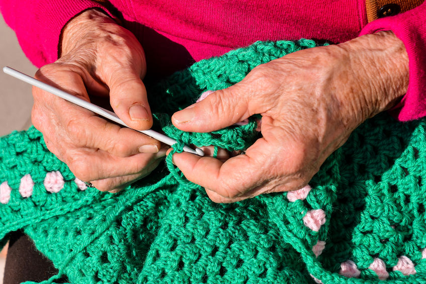 Pair of hands crocheting