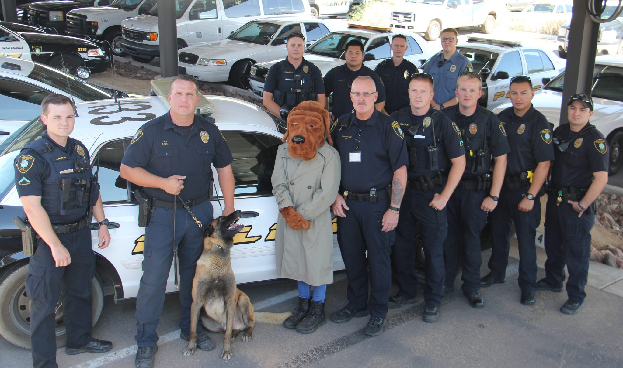 CGPD officers, dog mascot and canine posing outside of the facility.