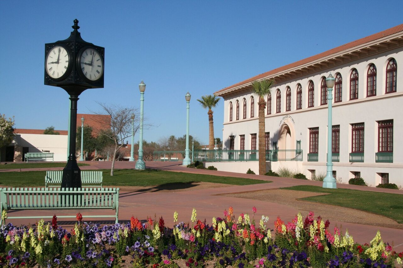 The front of city hall from an angle in the day time