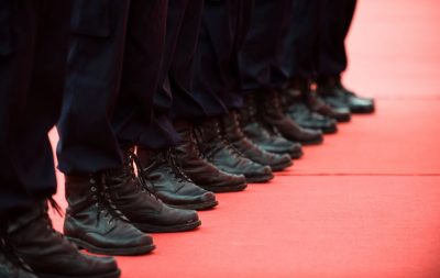 men in black boots standing in line