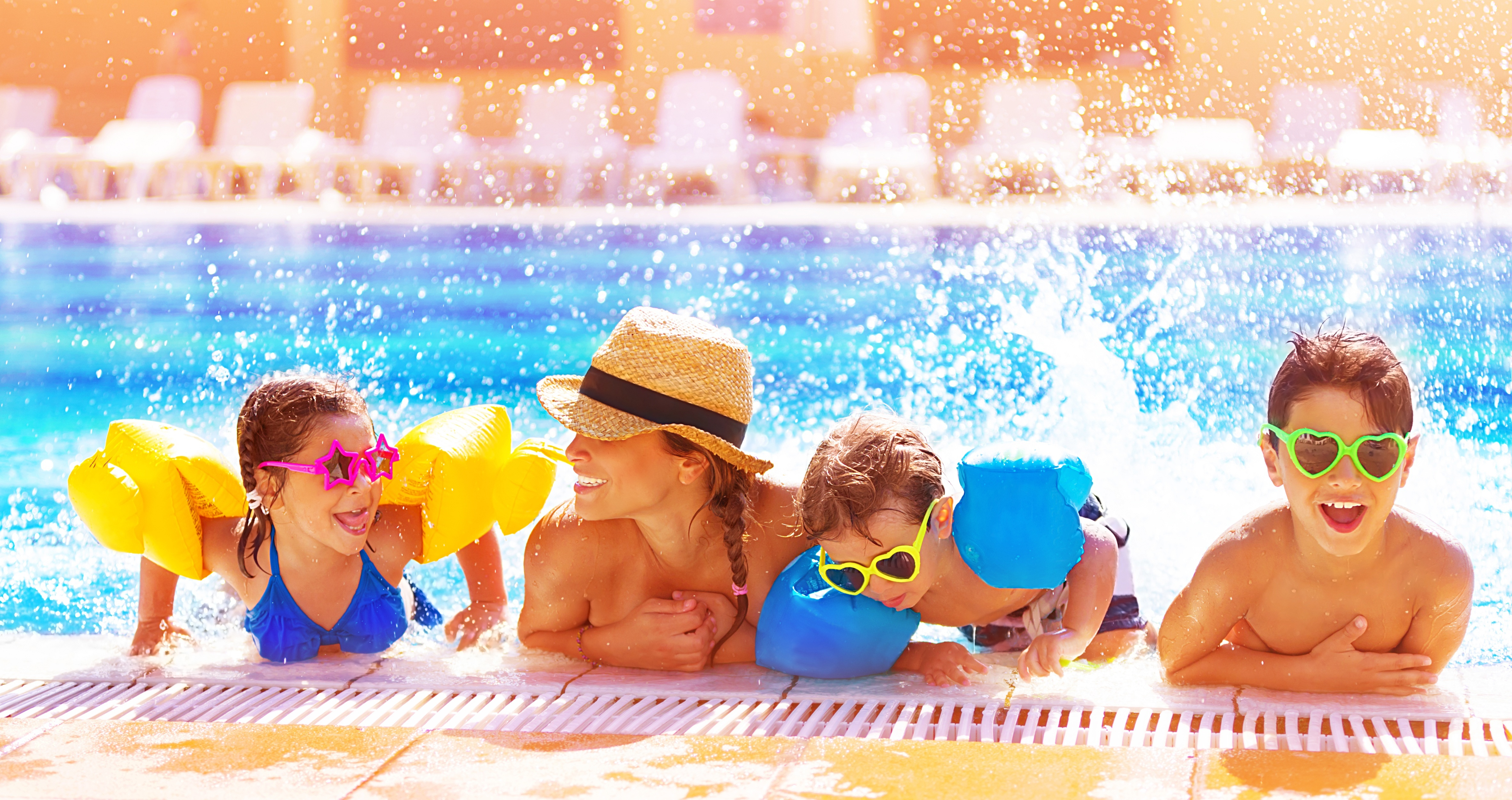 Mom and three children having fun in the pool