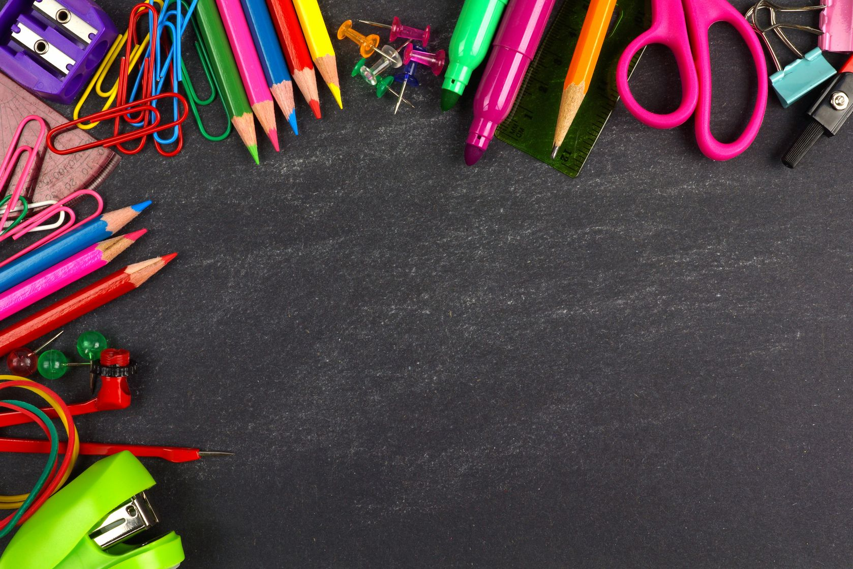 Art supplies on a chalkboard background