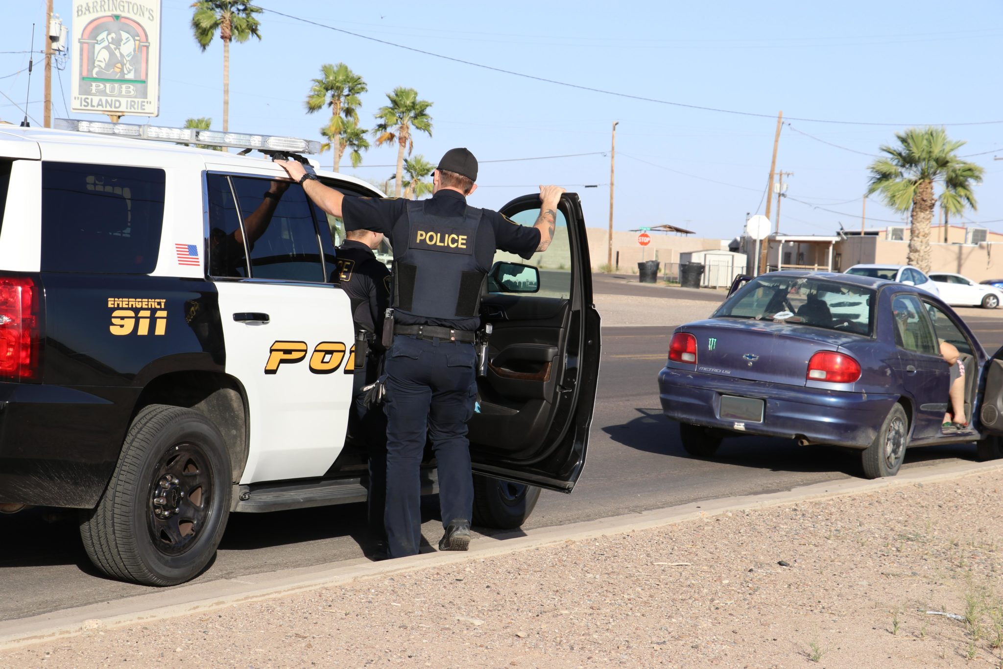 two police officers pulling over suspected car