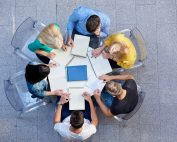 Youth sitting at a round table working together