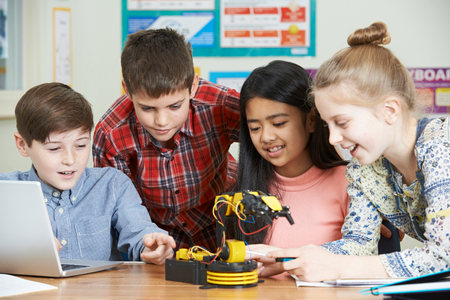 Children in science class studying robotics