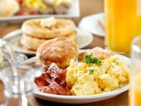 Breakfast of biscuit, eggs, bacon and hashbrown