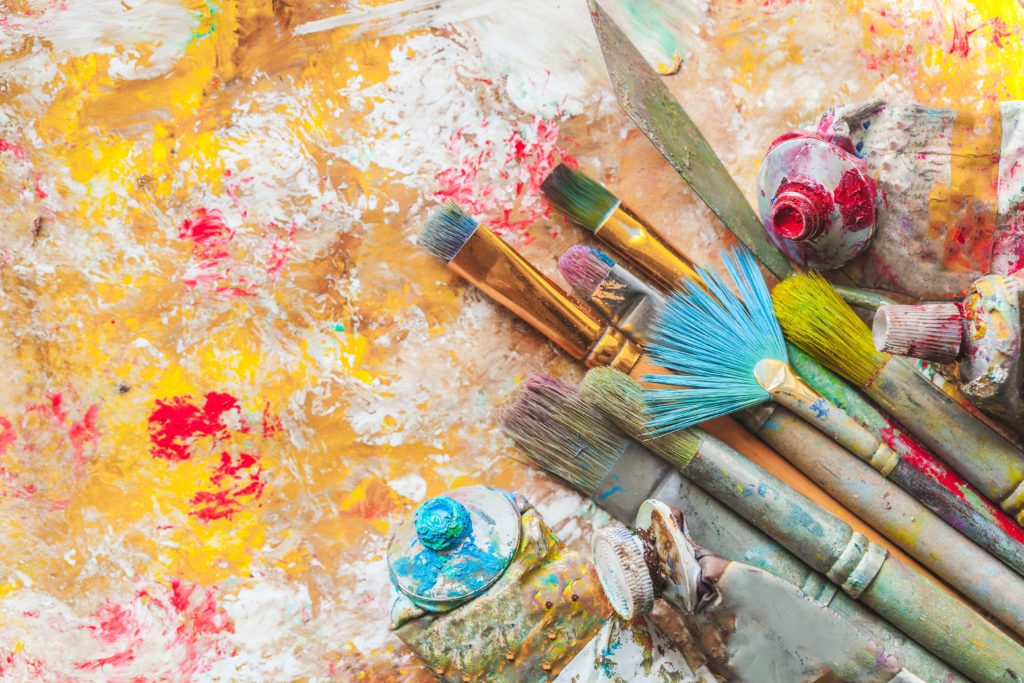 colorful paint brushes with splatter paint