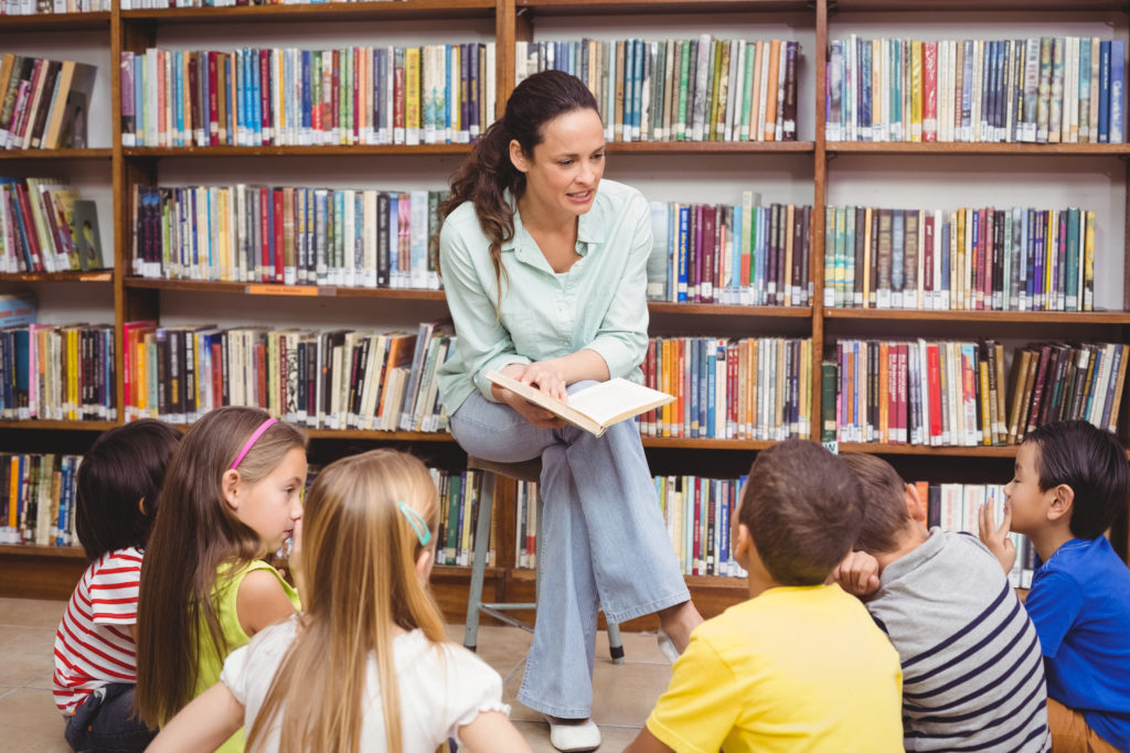 Pupils and teacher in the library for storytime