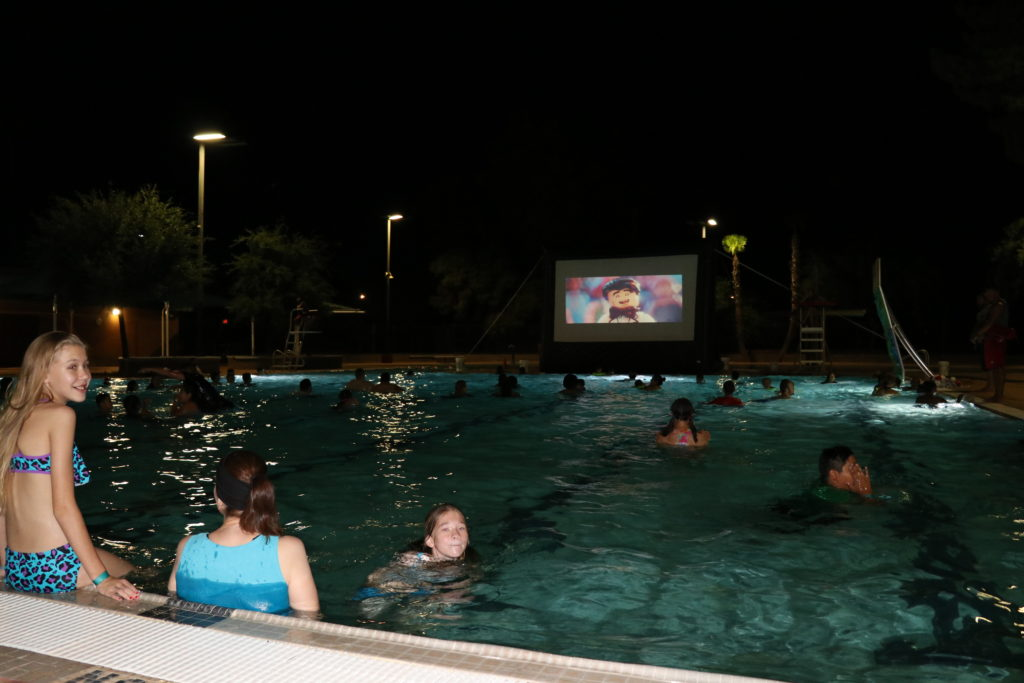 kids watching movie in the pool