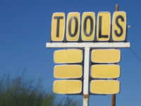 cutout of wood of the letters TOOLS