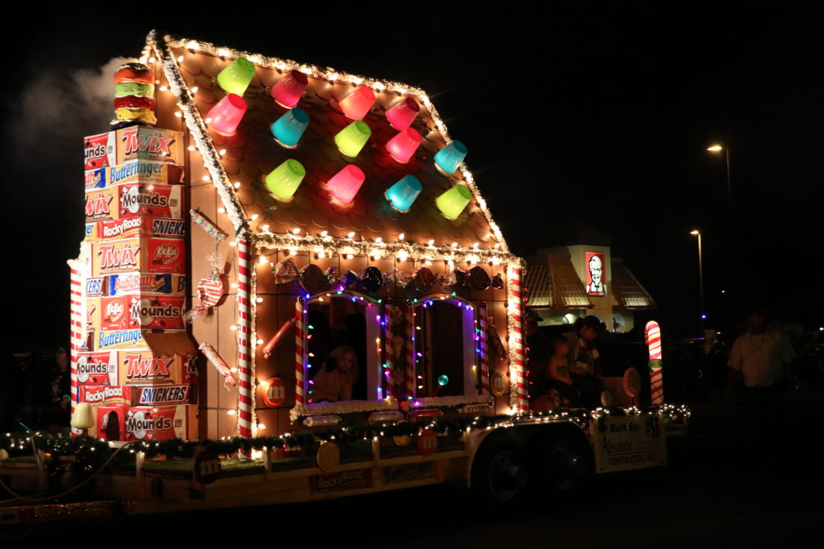 candy house made out of cardboard and lights on flat trailer