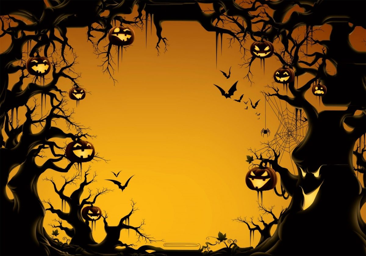 carved out pumpkin heads dangling from spooky tree branches