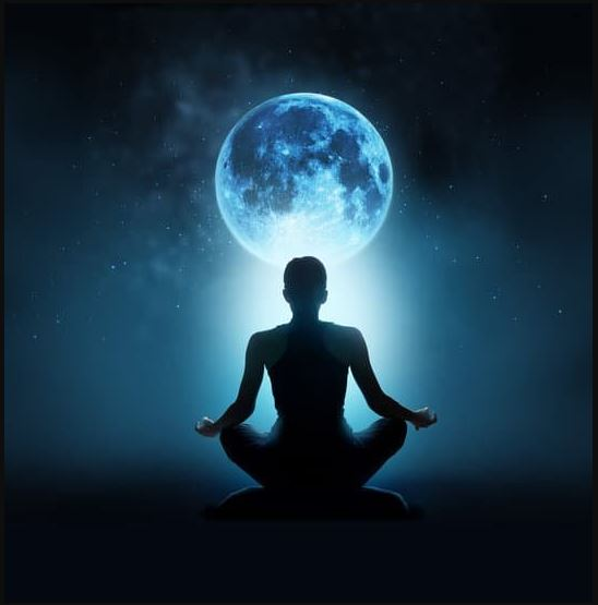 Picture of a moon and someone doing yoga